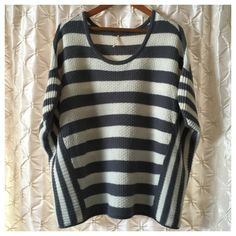 Free People gray & cream striped sweater You're looking at a Preloved Free People sweater in size medium.  Oversized style with short sleeves and a wide neck.  Chunky gray and cream horizontal stripes run along the chest and back, while smaller stripes in the same color run down the sides. Sweater does show some very minor pilling, but still in great condition. offers bundles for discounts PayPal trades Free People Sweaters Crew & Scoop Necks