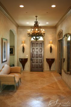 Great use of entryway space - I wonder where I could find wall sconce-tables this big?