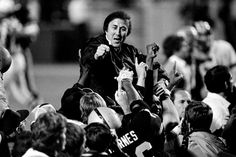 Super Bowl XVIII -- Los Angeles Raiders 38, Washington Redskins 9  JAN. 22, 1984 (Tampa Stadium, Tampa, Fla.) Coach Tom Flores gestures to members of the Los Angeles Raiders as they carry him off the field after their 38-9 victory over the Washington Redskins in Super Bowl XVIII. (AP Photo)