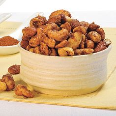In a microwave-safe bowl, or oven-safe ceramic bakeware, combine Domino® or C® Light, cinnamon, nutmeg and chili powder. Stir in water with a wooden spoon. Microwave uncovered on high for one minute; stir. Add nuts, mixing until well coated. Microwave an additional 3 to 4 minutes, stirring mixture after each minute. Spread nuts evenly onto a greased, foil-lined baking sheet to cool completely. Store in an airtight container.