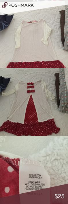 Ladies tunic Ladies cream tunic with red polka dot accent ruffle and back. Brand new, never worn! Love Story Tops Tunics