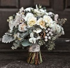 cool winter bouquet - white roses, pine needles, white anemones, dusty miller, pinecones, silver brunia