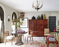 Brockschmidt & Coleman ~ English museum cabinets, 1940's chandelier; French dining chairs in a Rogers & Goffigon linen, custom-made pedestal table, 1930's Swedish side table