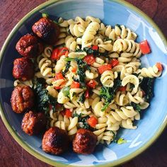 BBQ meatballs on top of red pepper & spinach pasta drizzled with lime infused olive oil & herbs.