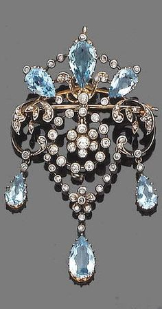 A belle epoque aquamarine and diamond brooch/pendant, circa 1910 The openwork cartouche set with rose-cut diamonds and pear-shaped aquamarines, suspending a circular millegrain-set old brilliant-cut diamond swag centre and terminating in three collet-set rose-cut diamond and pear-shaped aquamarine drops, mounted in silver and gold, diamonds approx. 0.70ct. total, length 6.0cm.