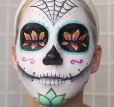 Typically associated with the Mexican Day of the Dead holiday, a sugar skull is an artistic and colorful way to amp up your Halloween makeup. It takes a bit more time and precision, but the outcome is worth it. Check out AlisonLovesJB's video for a full tutorial.