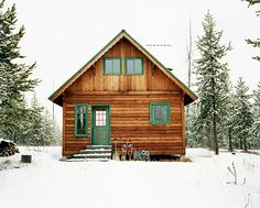 Classic cabin in the woods with green trim #winter