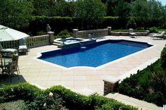 Grecian pool with saw cut concrete pool deck