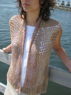 An openwork vest, when worked with double yarn overs in a filet mesh pattern, is as gentle as afternoon summer breezes. Pattern is sized for XS thru 3XL.   Knit in a light, linen-blend yarn, it barely touches the body, yet graces it with its feminine drape. Its sideways construction, coupled with short-row shaping at the sides and along the front, gives the piece its swingy, A-line silhouette. Sizes XS-3XL. Knit in sport weight or double knitting yarn and US size 6 and size 4 circular…