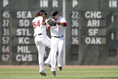 2 days ago: BOSTON, MA - JUNE 24: Cody Ross #7 of the Boston Red Sox and Darnell McDonald #54 celebrate after their 9-4 win over the Atlanta Braves in an interleague game at Fenway Park on June 24, 2012 in Boston, Massachusetts. (Photo by Winslow Townson/Getty Images