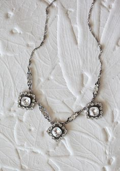 "Always A Bride Necklace By Anne Koplik 99.99 at shopruche.com. This exquisite silver hued necklace by Anne Koplik is sure to become a cherished heirloom with sparkling Swarovski crystals and charming antiqued accents.  12"" long, Pendants: 1"" long, 1"" wide"