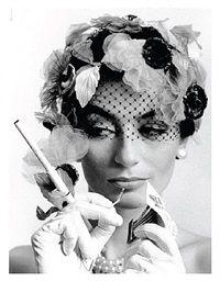 Anouk Aimée and cigarette holder, Paris Vogue by William Klein