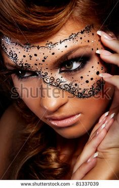 Pretty woman with creative makeup , mask on women's face - stock photo