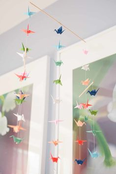 #paper-cranes, #nursery, #mobile, #artwork  Photography: Amanda Hein Photography - amandahein.com/  View entire slideshow: 20 Whimsical Nurseries on http://www.stylemepretty.com/collection/479/
