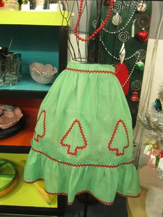 Vintage Christmas tree apron from Vendor 781 in booth 182. Priced at $12.00. Available at The Brass Armadillo Antique Mall - WheatRidge, CO! (303) 403-1677.