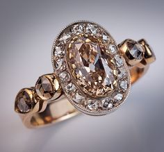 Fancy color orange brown diamond engagement ring. The ring was made in St. Petersburg between 1899 and 1904.
