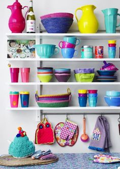 Bright and colorful dishes set against white storage <3 [Rice Denmark products]