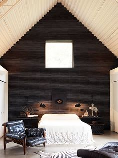 Attic room with dark slatted wooden walls. Photo by Marion Brenner; design by Erin Martin.