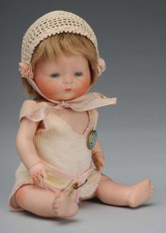 "Tunie Baby Doll -- German, circa 1924. Fully marked on head, ""C 1924 by E.I. Horsman Co., Inc. Made in Germany"". Blue sleeping eyes, original mohair wig, jointed shoulders and hips, and swivel neck. All correct body parts. Wearing original undergarments and Horsman pin. Condition (Excellent). Size 9"" T."