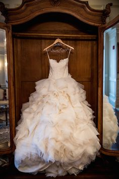 Strapless Wedding Dress with Dramatic Skirt    Photography: Danette Pascarella Photography   Read More:  http://www.insideweddings.com/weddings/catholic-ceremony-estate-reception-with-travel-themed-details/696/