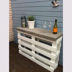 Tips & Tricks. I love this idea, join two wood pallets together and paint and add some stone paving to the top to make a cool outdoor bar counter.