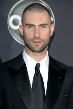 Lookin' so GQ. Adam, you can pull off the shaved head, but can we negotiate the neckbeard?