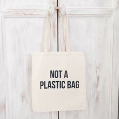 Cotton canvas cheap tote bag quote not a plastic door elkedagelbrich