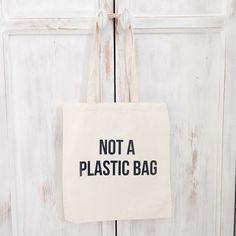 Cotton canvas cheap tote bag quote not a plastic door elkedagelbrich
