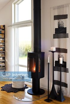 Modern living room with wood burning stove - Image No: 0049183 - GAP Interiors - Picture library specialising in Interiors, Lifestyle Rooms & Homes Modern Stoves, Painting Kitchen Cabinets White, Log Burning Stoves, Reclaimed Wood Desk, Wood Floor Kitchen, Door Design Interior, Wood Burner, My Living Room, Barbacoa