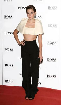 In case you were wondering what a crop top cape would look like, here's Emma Watson in a rad one from Balenciaga. <3