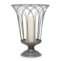 """Garden Sanctuary Wire Hurricane  Item #:  P91254        Gothic arches create a grand, urn-inspired holder for pillar candles, jars or our Garden Sanctuary Glass Hurricane, all sold separately. Weathered metal finish.   14 1/2""""h, 11""""dia."""