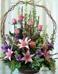 Willow Basket-filled with pink lilies, pink rose buds assorted greenery