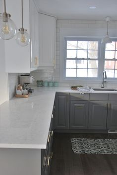 santa margherita victoria quartz countertops - via the sweetest digs Love the countertops.  Twotone cabinetry also nice.