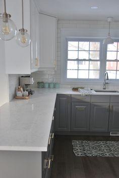 santa margherita victoria quartz countertops - via the sweetest digs Love the countertops.  Twotone cabinetry also nice.