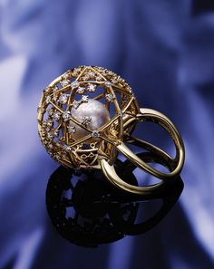 Mikimoto World of Creativity ring with a 12 mm white South Sea cultured pearl and diamonds set in 18-karat yellow gold.