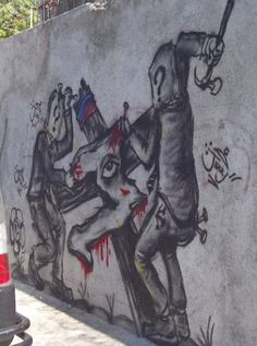 Haiti crucified to a cross.  This was found on a wall in Pétionville, Haiti.