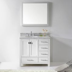 Product Features:Maximum Dimension: 36 in. W x 22 in. D x 35 in. HMain Cabinet: 35.2 in. W x 21.65 in. D x 33.46 in. HMirror: 35 in. W x 31 in. H x 1 in. DItalian Carrara White Marble Countertop1.18 in. countertop edge thicknessWhite Cabinet FinishWhite Mirror FinishSolid Oak WoodWater Resistant Low V.O.C Sealer5 Functional Drawers with Soft Closing HingesChrome Handles with Satin Nickel Highlights & Brushed Nickel KnobsStandard 8-inch Widespread Pre-Drilled HolesIncluded: (1) Cabinet, (1...