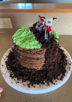 My nephew's birthday party is today. He's obsessed with dirt bikes! It's an all chocolate cake with brownie and oreo dirt : Baking Motorcycle Birthday Cakes, Motocross Birthday Party, Bike Birthday Parties, Dirt Bike Birthday, Motorcycle Cake, 7th Birthday, Birthday Ideas, Dirt Bike Cakes, Dirt Bike Party