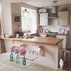 My kitchen with cream cupboards and wooden worktops. Emma Bridgwater accessories add a hint of country charm.: