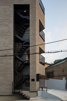 Image 16 of 20 from gallery of Micro Housing K / Architects Photograph by Dongkyu Yoon Library Architecture, Concept Architecture, Interior Architecture, Building Exterior, Building Design, Parking Building, Brick Arch, Archi Design, Outdoor Stairs