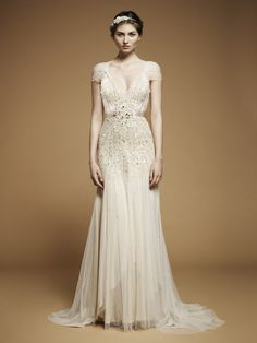 Gorgeous 20's styled wedding dress!    Now this is a 20's style dress but I hapen to love it! It has the caped sleeve, the deep plunge and a fitted waist, not to mention the white wine color!!