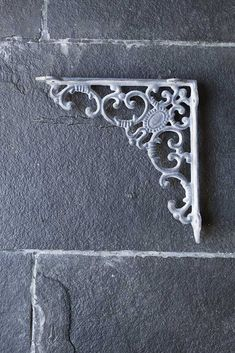 A stylish bracket for supporting a shelf, hanging basket or just for decoration purposes as it looks so good, shop our range of beautiful shelf brackets here. Cast Iron Shelf Brackets, Wall Brackets, Rockett St George, Hanging Flowers, Beautiful Wall, Hanging Baskets, Household Items, Interior Styling, Gardens