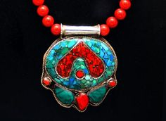 Vintage Tibetan Wisdom Pendant and Red Coral by SilkRoadJewelry