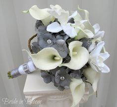 Wedding bouquet white silver slate grey bridal bouquet calla lilies & orchids. Oh take out the white and put something yellow :)