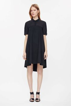 Made from a sheer textured top half and a a soft finish material skirt, this A-line dress flares towards the hemline. A slip-on design, it has kimono sleeves, in-seam pockets, a neat collar and hidden front button fastening.