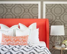 Sarah M. Dorsey Designs   Coral and gray bedroom with Sherwin-Williams Coastal Cool Wallpaper Collection accented with brass nailhead trim framing coral wingback headboard.