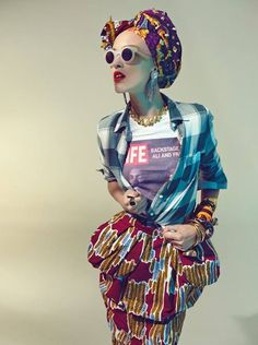 I like Stella Jean, ok. Red, yellow and blue printed skirt with gathering detail at hips, worn with blue checked shirt and printed t-shirt. (STELLA JEAN S/S Fashion Prints, Fashion Art, Fashion Models, High Fashion, Fashion Design, Stella Jean, African Inspired Fashion, African Fashion, Ankara Fashion