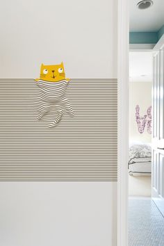 This wall decal is based on the Threadless t-shirt design M!aw by Wacharapong.