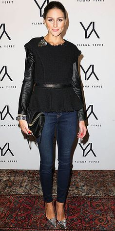 Olivia Palermo in leather sleeves, peplum waist top and oversized clutch.  Multiple trends in one look can only mean one thing...fashion week.