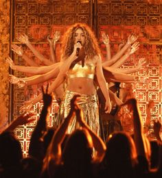"Shakira gets a hand (or about 16) for her performance of ""Hips Don't Lie"" at the 49th GRAMMY Awards in 2007"